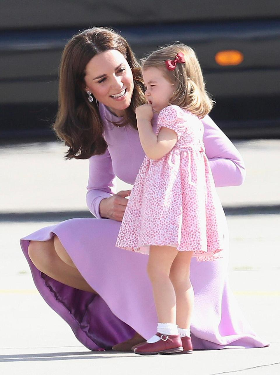 """<p>Not all days are smiley and celebratory, even when you're a royal! Kate diffused an impatient Charlotte during a visit to Germany in 2017. """"Her motherly values are clear to see,"""" says a close friend.</p>"""