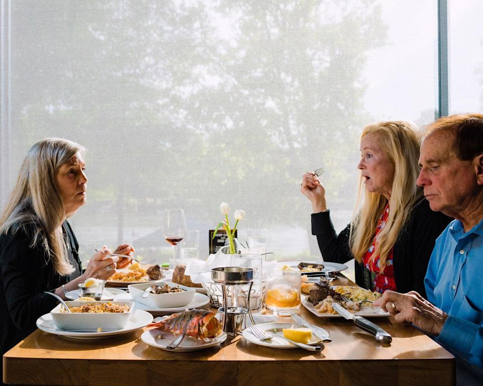 """<div class=""""caption""""> Diners at a table in the dining room at Ray's On The River </div> <cite class=""""credit"""">DUSTIN CHAMBERS</cite>"""