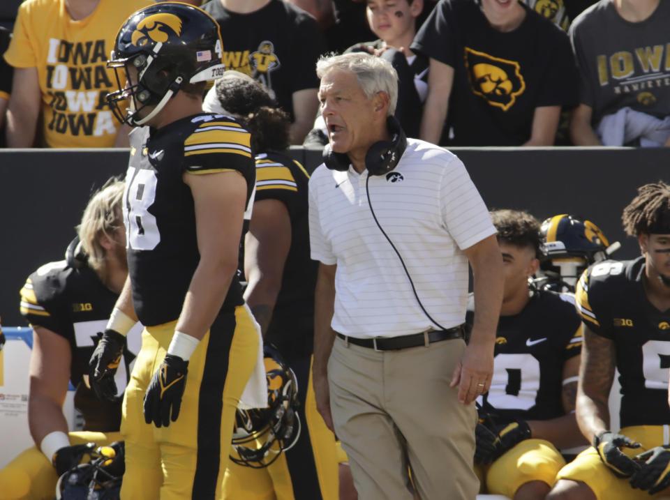Iowa head coach Kirk Ferentz talks with his team on the sideline during the first quarter of an NCAA college football game against Colorado State, Saturday, Sept. 25, 2021, in Iowa City, Iowa. (AP Photo/Ron Johnson)