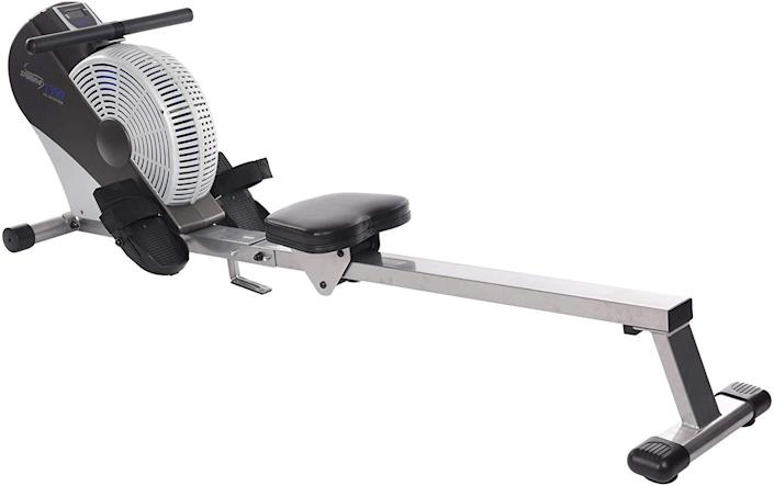 """Having your own rower typically means giving up valuable real estate in your home, but this affordable and versatile option will help you tone up and get in your cardio without taking over your spare room. The <a href=""""https://www.amazon.com/dp/B003YPZWT2"""" rel=""""nofollow noopener"""" target=""""_blank"""" data-ylk=""""slk:Stamina ATS Air Rower"""" class=""""link rapid-noclick-resp"""">Stamina ATS Air Rower</a> uses wind-based resistance, allowing you to intensify your workout, and features a multifunctional monitor to track speed, distance, time, and calories burned. Done with your rowing? Just fold it in half and roll it over to its hiding place."""