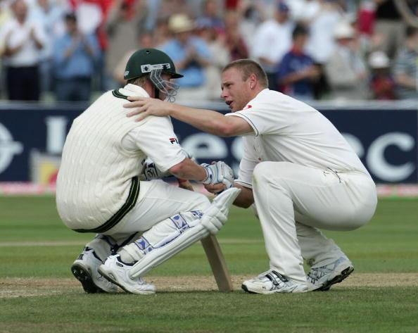 BIRMINGHAM, UNITED KINGDOM - AUGUST 07: Andrew Flintoff of England consoles Brett Lee of Australia after England defeated Australia on day four of the Second npower Ashes Test match between England and Australia at Edgbaston on August 7, 2005 in Birmingham, England. (Photo by Tom Shaw/Getty Images)