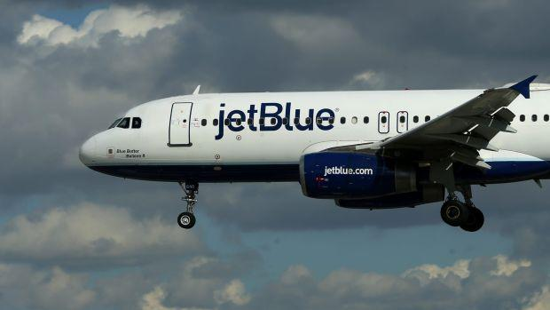 A JetBlue aircraft comes in to land at Long Beach Airport