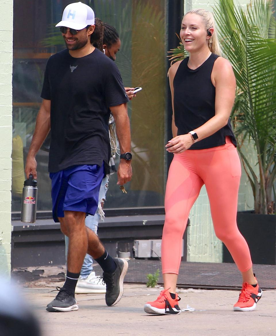<p>Lindsey Vonn and new flame Diego Osorio take a walk through Soho after finishing a workout in N.Y.C. on July 20.</p>