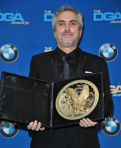 Alfonso Cuarón poses in the press room of the the 66th Annual DGA Awards Dinner at the Hyatt Regency Century Plaza Hotel on Saturday, Jan. 25, 2014, in Los Angeles, Calif. (Photo by Richard Shotwell Invision/AP)