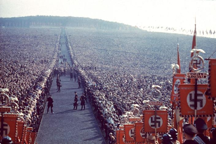 """Nazi rally, 1937. (Hugo Jaeger—Time & Life Pictures/Getty Images) <br> <br> <a href=""""http://life.time.com/world-war-ii/nazi-propaganda-and-the-myth-of-aryan-invincibility/#1"""" rel=""""nofollow noopener"""" target=""""_blank"""" data-ylk=""""slk:Click here to see the full collection at LIFE.com"""" class=""""link rapid-noclick-resp"""">Click here to see the full collection at LIFE.com</a>"""