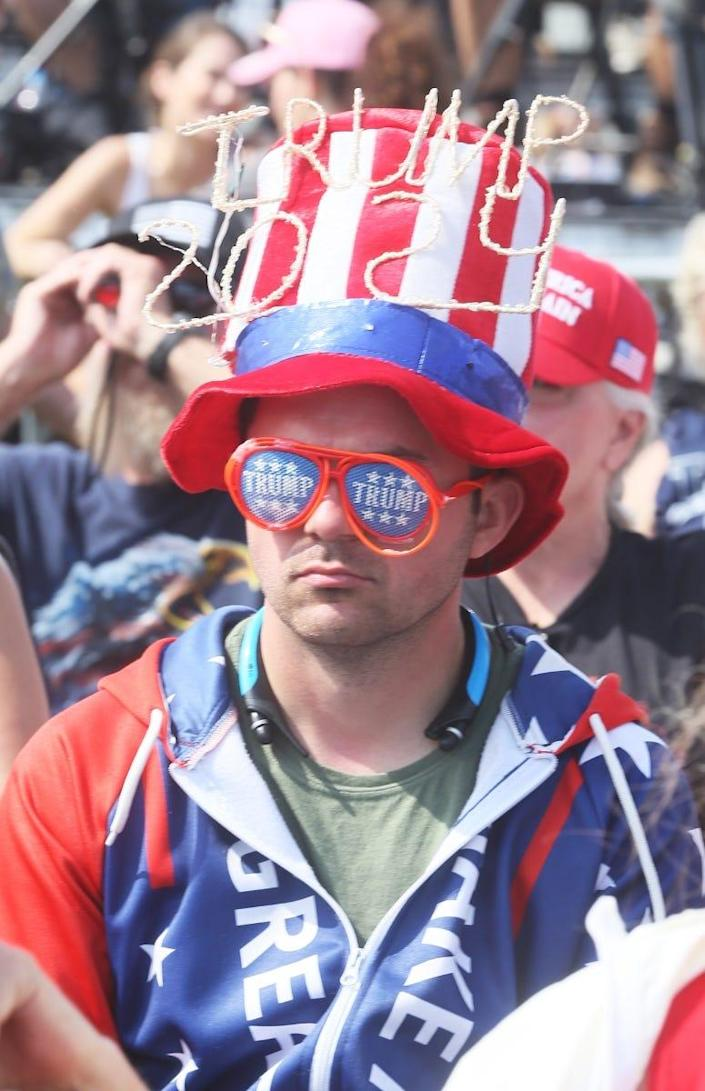 A supporter of former President Donald Trump before a rally Saturday at the Lorain County Fairgrounds in Ohio.