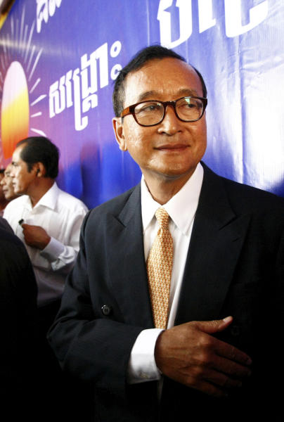 Cambodia National Rescue Party (CNRP) President Sam Rainsy stands after a press conference in his main party headquarters in Chak Angre Leu in Phnom Penh, Cambodia, Monday, July 29, 2013. Cambodia's opposition party CNRP said Monday it would challenge the results of a general election in which it made impressive gains even though the ruling party of Prime Minister Hun Sen retained power. (AP Photo/Heng Sinith)