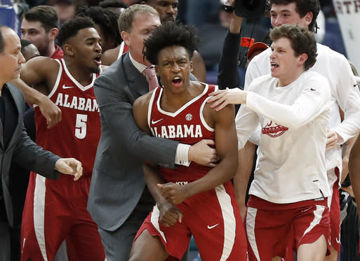 Alabama's Collin Sexton, center, is congratulated by teammates after making a game-winning basket at the buzzer Thursday to defeat Texas A&M 71-70. (AP)
