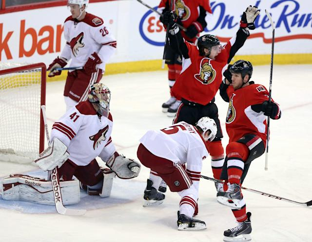 Ottawa Senators' Marc Methot, right front, celebrates his goal with teammate Kyle Turris (7) as Phoenix Coyotes goaltender Mike Smith (41) watches during the first period of an NHL hockey game Saturday, Dec. 21, 2013, in Ottawa, Ontario. (AP Photo/The Canadian Press, Fred Chartrand)