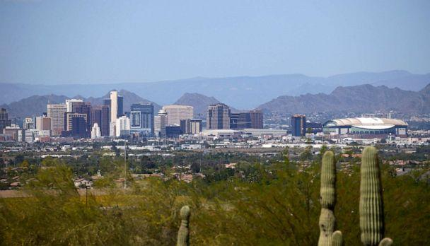 PHOTO: The downtown Phoenix skyline is easier to see, April 7, 2020, as fewer motorists in Arizona are driving, following the state stay-at-home order due to the coronavirus, and it appears to be improving the air quality. (Ross D. Franklin/AP)