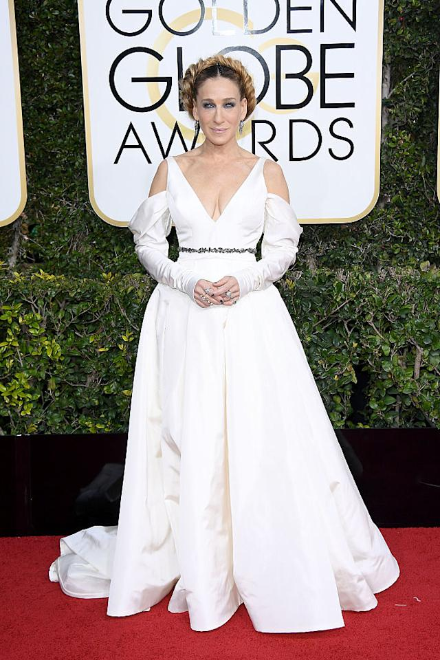 """<p>Sarah Jessica Parker wore a light ivory, silk faille, plunging V-neck gown with draped skirt and sleeves and jeweled belt detail from Vera Wang. The combination of Parker's <a rel=""""nofollow"""" href=""""https://www.yahoo.com/style/whats-up-with-all-the-weird-sleeves-at-the-golden-globes-030842498.html"""">peekaboo sleeves</a> and the big updo obviously wasn't a good one. As commenter on TMZ put it, the <em>Divorce</em> actress looked like """"Martha Washington's mother."""" (Photo: Getty Images) </p>"""