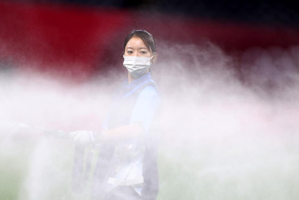 <p>A member of ground staff wearing a face mask waters the pitch at half time during the Men's First Round Group C match between Egypt and Spain during the Tokyo 2020 Olympic Games at Sapporo Dome on July 22, 2021 in Sapporo, Hokkaido, Japan. (Photo by Masashi Hara/Getty Images)</p>