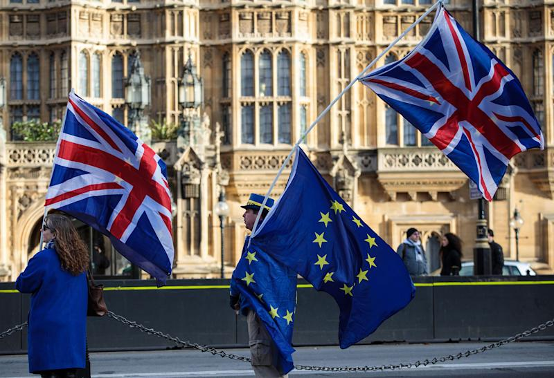 Anti-brexit protesters wave Union Jack and EU flags outside the Houses of Parliament on December 8, 2017: Getty Images