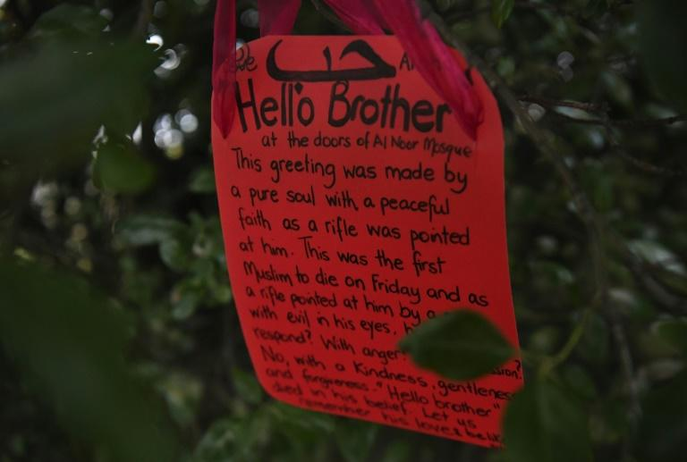 "A note with a ""Hello Brother"" message left in a tree outside the Al Noor mosque in Christchurch Thursday"
