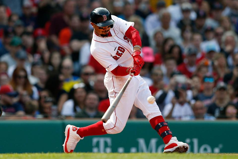 Boston Red Sox's Mookie Betts hits a single during the sixth inning of a baseball game against the Baltimore Orioles in Boston, Saturday, April 13, 2019. (AP Photo/Michael Dwyer)