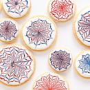 """<p>While July 4th is all about celebrating America's independence, <a href=""""https://www.womansday.com/food-recipes/g1180/4th-of-july-party-ideas/"""" rel=""""nofollow noopener"""" target=""""_blank"""" data-ylk=""""slk:4th of July parties"""" class=""""link rapid-noclick-resp"""">4th of July parties</a> are all about the food. It looks like Americans will be able to host small, outdoor gatherings for Independence Day this year, which means it's time to break out your best <a href=""""https://www.womansday.com/food-recipes/food-drinks/g2440/4th-of-july-recipes/"""" rel=""""nofollow noopener"""" target=""""_blank"""" data-ylk=""""slk:4th of July recipes"""" class=""""link rapid-noclick-resp"""">4th of July recipes </a>and plan your Independence Day party menu. From your <a href=""""https://www.womansday.com/food-recipes/food-drinks/g2445/4th-of-july-appetizers/"""" rel=""""nofollow noopener"""" target=""""_blank"""" data-ylk=""""slk:4th of July appetizers"""" class=""""link rapid-noclick-resp"""">4th of July appetizers</a> to your <a href=""""https://www.womansday.com/food-recipes/food-drinks/g1594/4th-of-july-desserts/"""" rel=""""nofollow noopener"""" target=""""_blank"""" data-ylk=""""slk:red, white, and blue desserts"""" class=""""link rapid-noclick-resp"""">red, white, and blue desserts</a>, you can show off your patriotism through your food all day long. And while <a href=""""https://www.womansday.com/food-recipes/food-drinks/g2447/4th-of-july-cake-and-cupcakes/"""" rel=""""nofollow noopener"""" target=""""_blank"""" data-ylk=""""slk:4th of July cakes"""" class=""""link rapid-noclick-resp"""">4th of July cakes</a> can double as stunning centerpieces, 4th of July cookies are likely a better choice for your backyard gathering if you're looking to avoid sharing dishes. </p><p>Of course, your party dessert doesn't actually have to be red, white, and blue to delight your guests. But why not make patriotic cookies that look as pretty as your <a href=""""https://www.womansday.com/home/crafts-projects/g2446/4th-of-july-crafts/"""" rel=""""nofollow noopener"""" target=""""_blank"""" data-ylk=""""slk:4th of July decor"""" class=""""link rapid"""