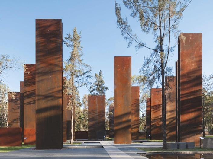 Memorializing lives lost in Mexico's drug war, local firm Gaeta-Springall Arquitectos's 2012 Memorial to the Victims of Violence in Mexico used CorTen steel, water, light, and trees to create a poetic, impactful experience. Quotes on memory, violence, and other topics are inscribed on many of the 70 steel panels that are set vertically and horizontally throughout the space. A 13,000-square-foot reflecting pool is partially topped with grates, allowing visitors to walk across the water.