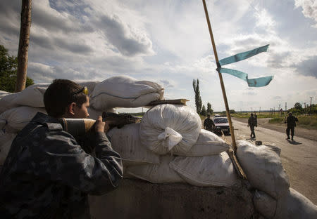 Pro-Russian separatists man a road checkpoint outside the town of Lysychansk in Luhansk
