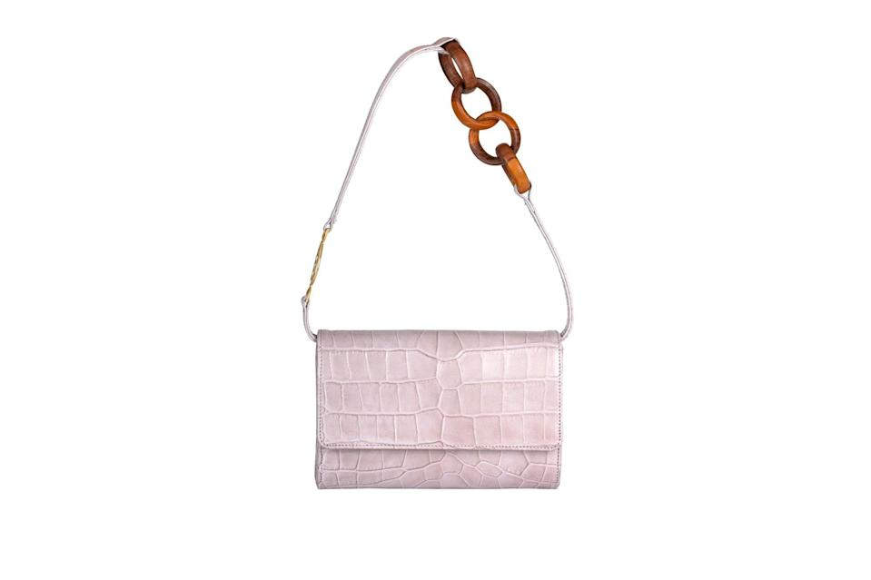 "$1295, Brother Vellies. <a href=""https://brothervellies.com/collections/waitlist/products/lijadu-billfold-in-lavender"" rel=""nofollow noopener"" target=""_blank"" data-ylk=""slk:Get it now!"" class=""link rapid-noclick-resp"">Get it now!</a>"