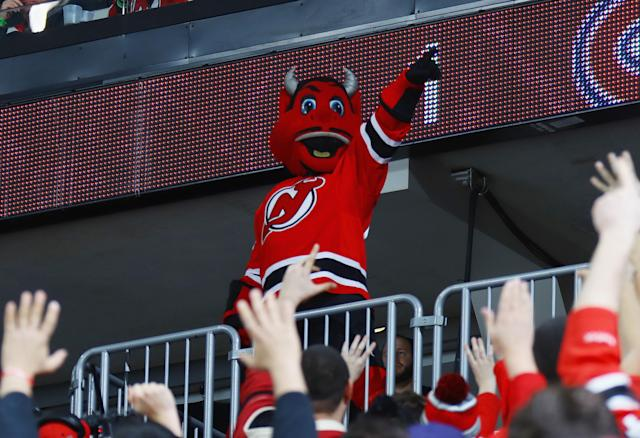 NEWARK, NJ - JANUARY 20: The 'New Jersey Devil' mascot gets the fans going during the game between the New Jersey Devils and the Montreal Canadiens at the Prudential Center on January 20, 2017 in Newark, New Jersey. (Photo by Bruce Bennett/Getty Images)