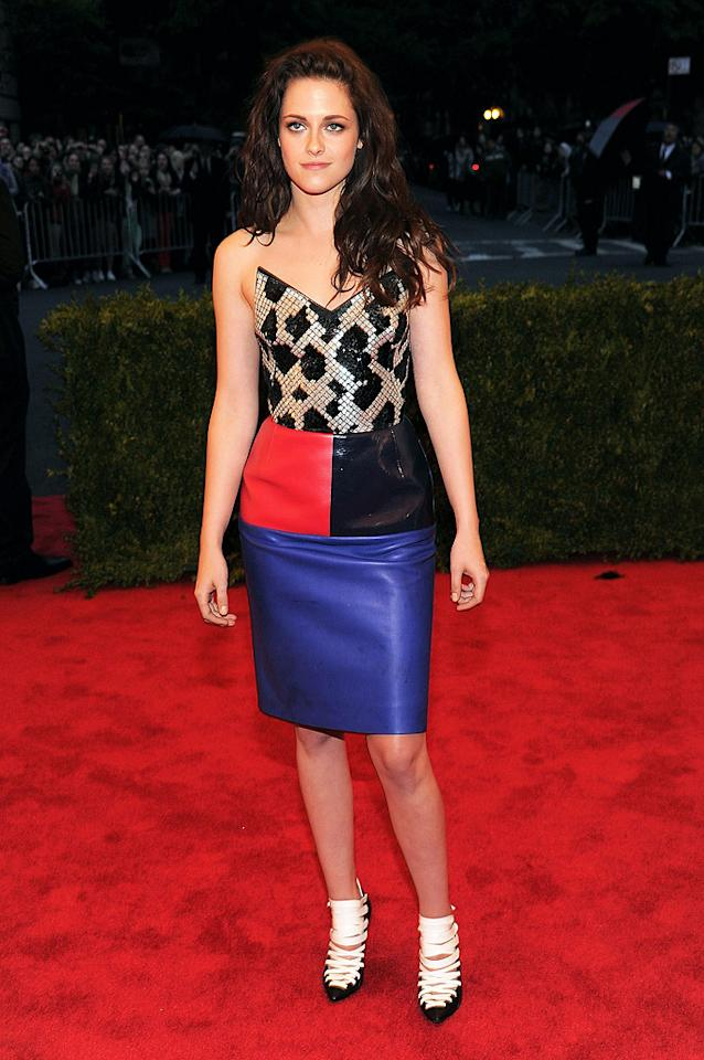 "Is that a smile we see? The usually pouty Kristen Stewart looked <i>almost</i> happy on the red carpet in her strapless multi-color <b><span style=""font-weight:normal;"">Balenciaga dress and funky black-and-white shoes.<br></span></b>"