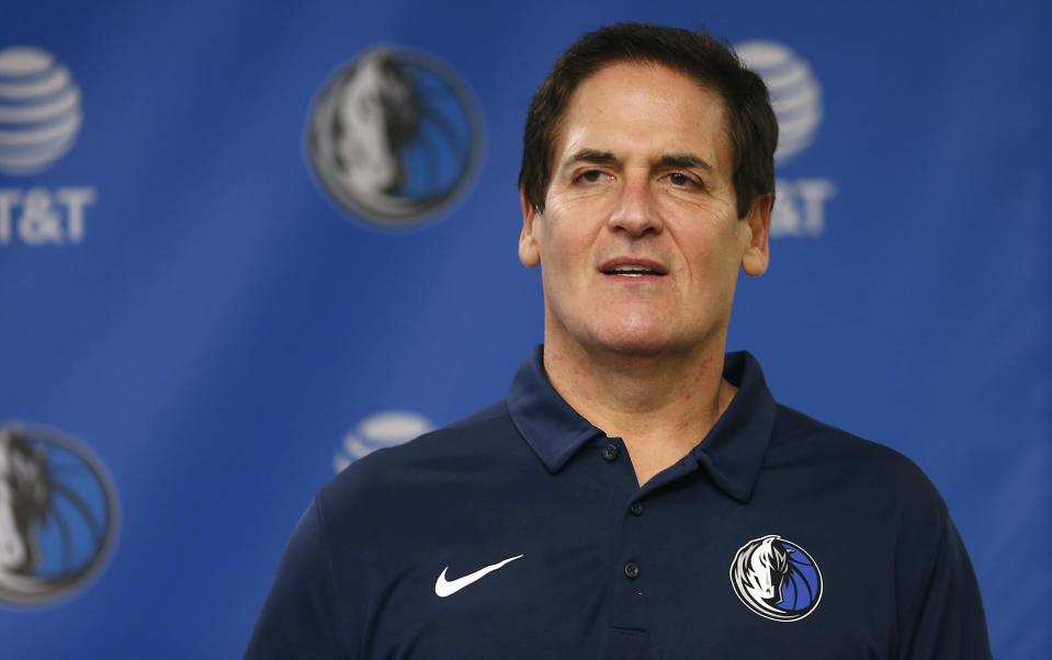 Dallas Mavericks owner Mark Cuban stands on stage before Cynthia Marshall, new interim CEO of the team, is introduced during a news conference, Monday, Feb. 26, 2018, in Dallas. (AP)