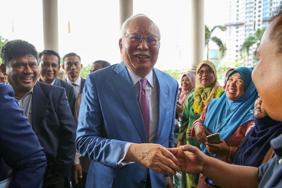 Former prime minister Datuk Seri Najib Razak is greeted by supporters at the Kuala Lumpur Courts Complex December 3, 2019. — Picture by Yusof Mat Isa