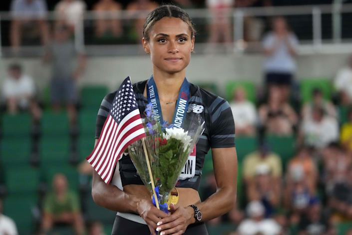 Sydney McLaughlin poses with gold medal after winning the women's 400m hurdles in a world-record 51.90 during the US Olympic Team Trials at Hayward Field.