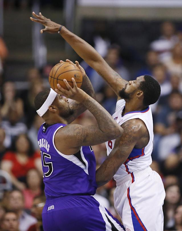 CORRECTS DAY OF WEEK TO SATURDAY - Sacramento Kings center DeMarcus Cousins shoots the ball as Los Angeles Clippers center DeAndre Jordan defends him during the first half of an NBA basketball game in Los Angeles, Saturday, April 12, 2014. (AP Photo/Danny Moloshok)