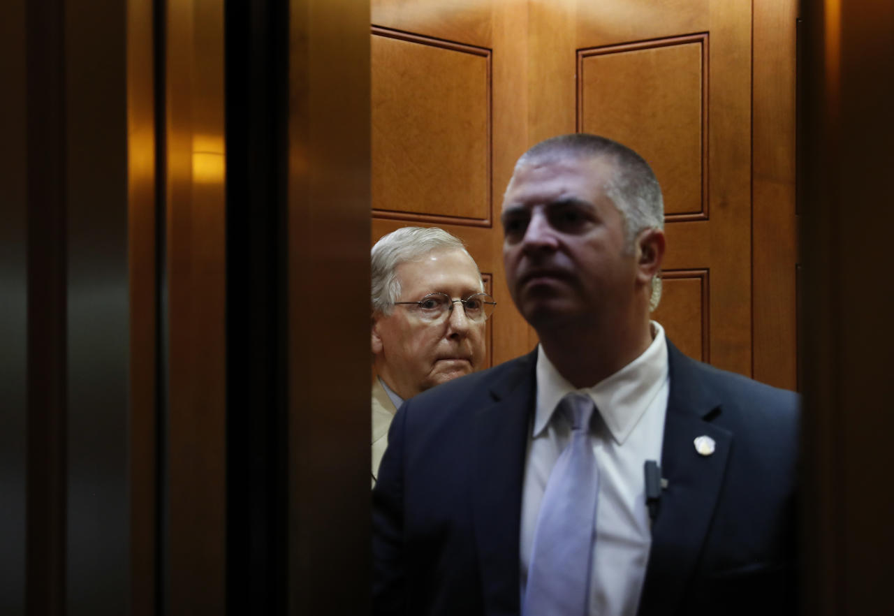 """Senate Majority Leader Mitch McConnell of Ky., looks out after boarding an elevator Capitol Hill in Washington, Monday, June 26, 2017. Senate Republicans unveil a revised health care bill in hopes of securing support from wavering GOP lawmakers, including one who calls the drive to whip his party's bill through the Senate this week """"a little offensive."""" (AP Photo/Carolyn Kaster)"""