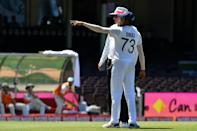 India's Mohammed Siraj points out to umpire Paul Reiffel where he heard something said in the crowd, just before the tea break of the third Test against Australia in Sydney on Sunday