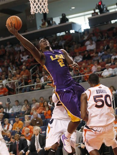 LSU forward Johnny O'Bryant, (2), shoots over the defense of Auburn's Willy Kouassi (50) during the first half of their NCAA college basketball game at the Auburn Arena in Auburn, Ala., Saturday, March 3, 2012.(AP Photo/Dave Martin)