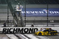 Brad Keselowski (2) crosses the finish line to win a NASCAR Cup Series auto race Saturday, Sept. 12, 2020, in Richmond, Va. (AP Photo/Steve Helber)