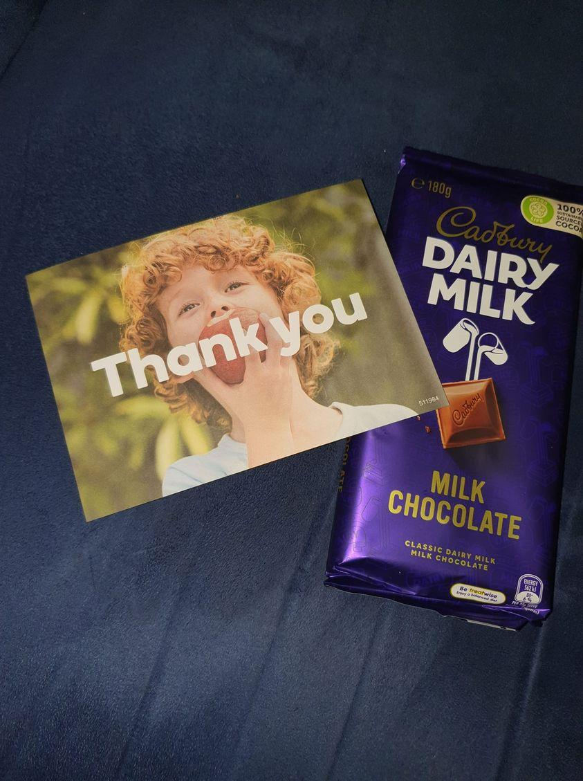 A photo of a Cadbury chocolate block and a Woolworths thank you card a shopper received. Source: Facebook