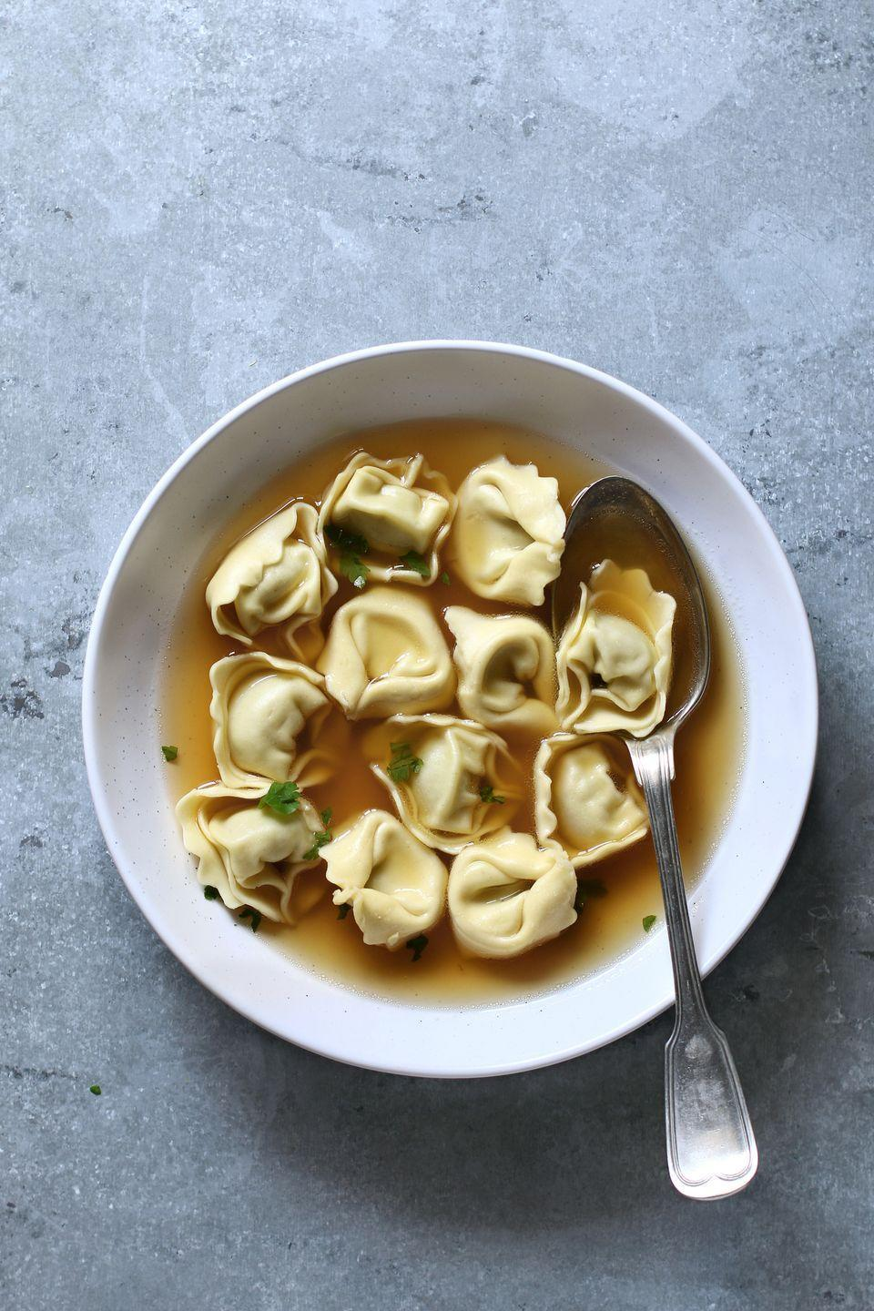 """<p>Traditionally, <a href=""""https://www.delish.com/uk/cooking/recipes/a28828808/bolognese-tortellini-bake-recipe/"""" rel=""""nofollow noopener"""" target=""""_blank"""" data-ylk=""""slk:tortellini"""" class=""""link rapid-noclick-resp"""">tortellini</a> are stuffed with a mix of meat then served doused in butter, or in a broth.</p>"""