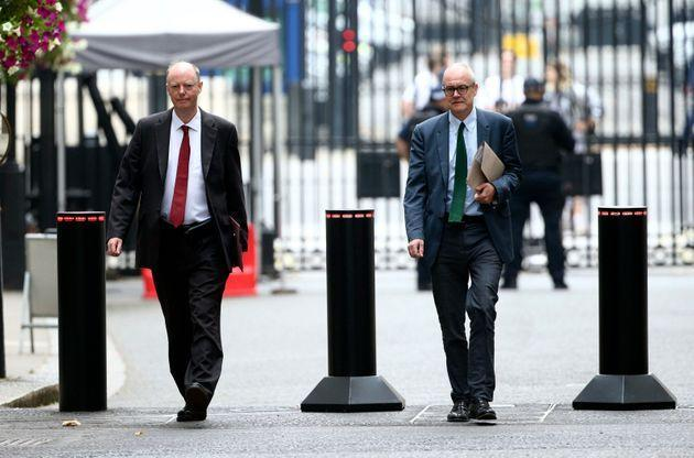 The government's chief medical officer Chris Whitty, left, and chief scientific adviser Patrick Vallance arrive in Downing Street, London, Monday Sept. 21, 2020.