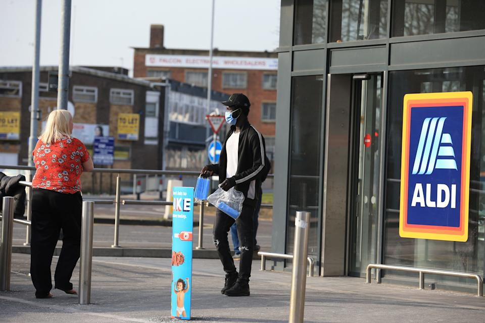 "A man sells face masks outside a supermarket the centre of  Leeds, northern England, on March 24, 2020 after Britain ordered a lockdown to slow the spread of the novel coronavirus. - Britain was under lockdown March 24, its population joining around 1.7 billion people around the globe ordered to stay indoors to curb the ""accelerating"" spread of the coronavirus. (Photo by Lindsey Parnaby / AFP) (Photo by LINDSEY PARNABY/AFP via Getty Images)"