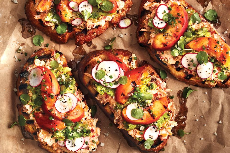 """For an appetizer that brings together all of the best flavors of the warmer months, pile grilled bread with smoky pimiento cheese, avocado, grilled peaches, and crunchy radish slices. <a href=""""https://www.epicurious.com/recipes/food/views/grilled-peach-toast-with-pimiento-cheese?mbid=synd_yahoo_rss"""" rel=""""nofollow noopener"""" target=""""_blank"""" data-ylk=""""slk:See recipe."""" class=""""link rapid-noclick-resp"""">See recipe.</a>"""