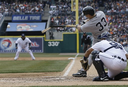 New York Yankees designated hitter Travis Hafner breaks his bat during the third inning of a baseball game against the Detroit Tigers in Detroit Sunday April 7, 2013. (AP Photo/Carlos Osorio)