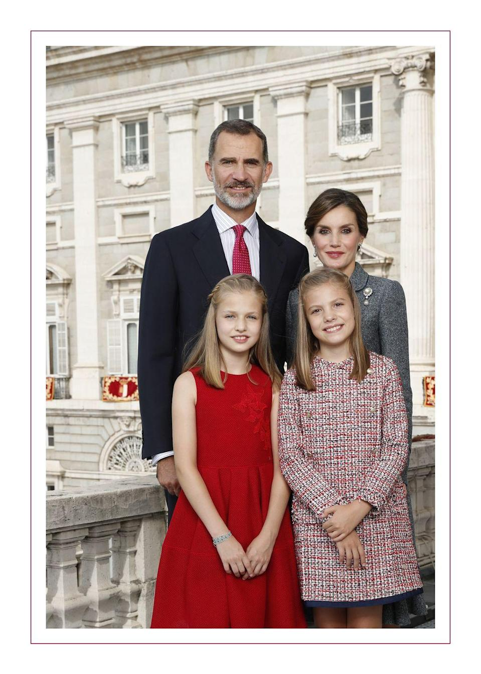 """<p>Queen Letizia <a href=""""https://www.townandcountrymag.com/society/tradition/g14416793/spanish-royal-family-christmas-cards/"""" rel=""""nofollow noopener"""" target=""""_blank"""" data-ylk=""""slk:posed for a Christmas portrait"""" class=""""link rapid-noclick-resp"""">posed for a Christmas portrait</a> alongside her husband, Felipe, and their daughters Leonor and Sofia. </p>"""