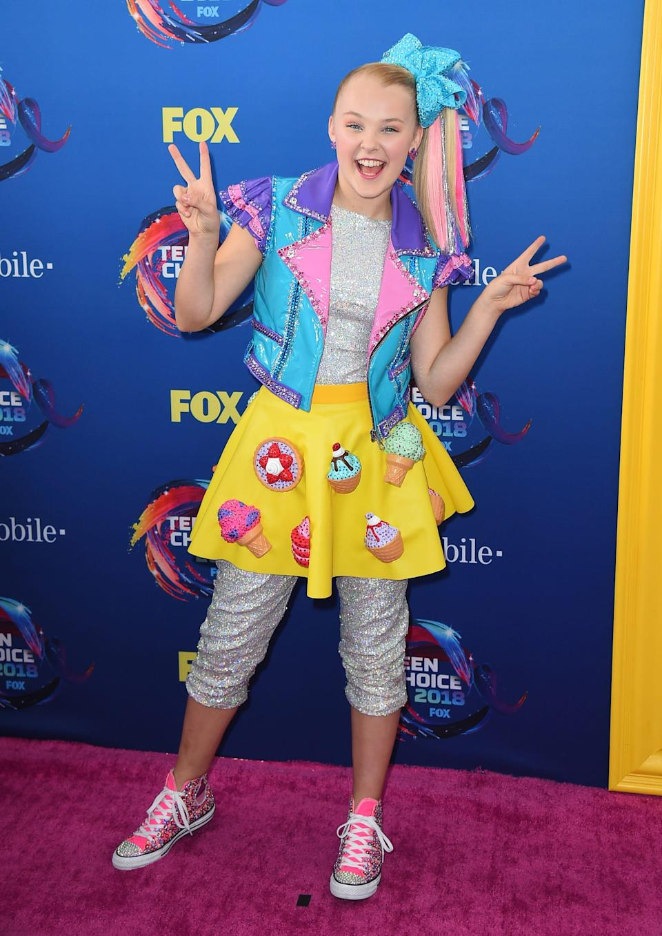 JoJo Siwa arrives at the Teen Choice Awards at The Forum on Sunday, Aug. 12, 2018, in Inglewood, Calif. (Photo by Jordan Strauss/Invision/AP) ORG XMIT: CAPM116