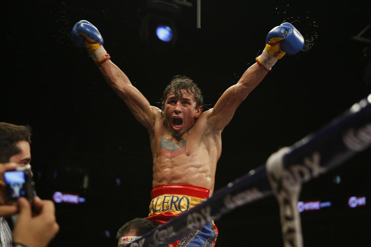 <p>xEdwin Valero, of Venezuela, celebrates his victory over Mexico's Antonio DeMarco at a WBC lightweight title fight in Monterrey, Mexico, Saturday, Feb. 6, 2010. Valero won on a TKO after DeMarco sat in his corner and declined to come out for the 10th round. On Valero's chest is a tattoo of Venezuela's President Hugo Chavez and his nation's flag. (AP Photo/Eduardo Verdugo)</p>