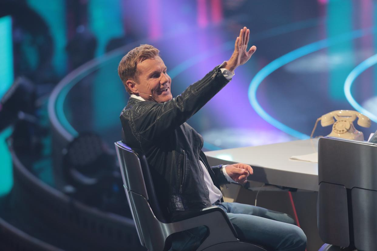 COLOGNE, GERMANY - APRIL 13: Dieter Bohlen lifts his arm during the second event show of the tv competition