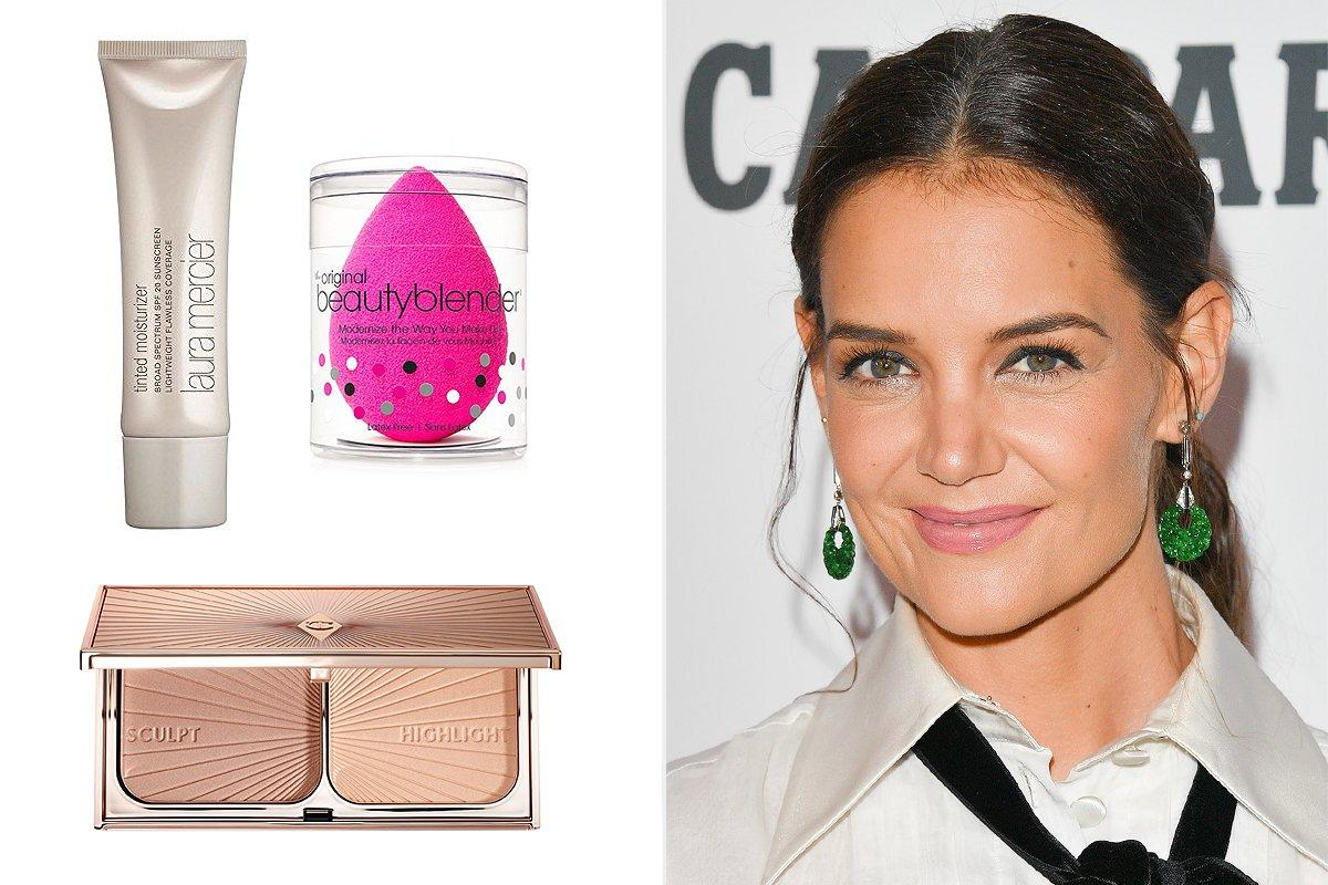 """You can get a faux look with a few key products, says Katie Holmes's makeup artist Genevieve Herr. Start with a sheer tinted moisturizer, pressing it into your skin with a damp sponge for a natural effect, so it looks """"fresh, young and not overdone,"""" Herr says. Set it with a translucent finishing powder, then blend bronzer all over with a brush for even coverage. Finish by using your fingers to tap highlighter on top of the cheekbones.  <strong>Buy It!</strong> <a href=""""https://www.sephora.com/product/tinted-moisturizer-broad-spectrum-P109936"""">Laura Mercier Tinted Moisturizer, $47; sephora.com,</a> <a href=""""https://click.linksynergy.com/deeplink?id=93xLBvPhAeE&mid=2417&murl=https%3A%2F%2Fwww.sephora.com%2Fproduct%2Fbeautyblender-P228913&u1=PEO%2CAllYourBurningBeautyQuestions%2CAnswered%21%2Ckaitlynfrey%2CUnc%2CGal%2C7056880%2C201910%2CI"""" target=""""_blank"""" rel=""""nofollow"""">Beautyblender, $20; sephora.com</a> and <a href=""""https://click.linksynergy.com/deeplink?id=93xLBvPhAeE&mid=2417&murl=https%3A%2F%2Fwww.sephora.com%2Fproduct%2Ffilmstar-bronze-glow-contour-duoP433528&u1=PEO%2CAllYourBurningBeautyQuestions%2CAnswered%21%2Ckaitlynfrey%2CUnc%2CGal%2C7056880%2C201910%2CI"""" target=""""_blank"""" rel=""""nofollow"""">Charlotte Tilbury Filmstar Bronze & Glow, $68; sephora.com</a>"""