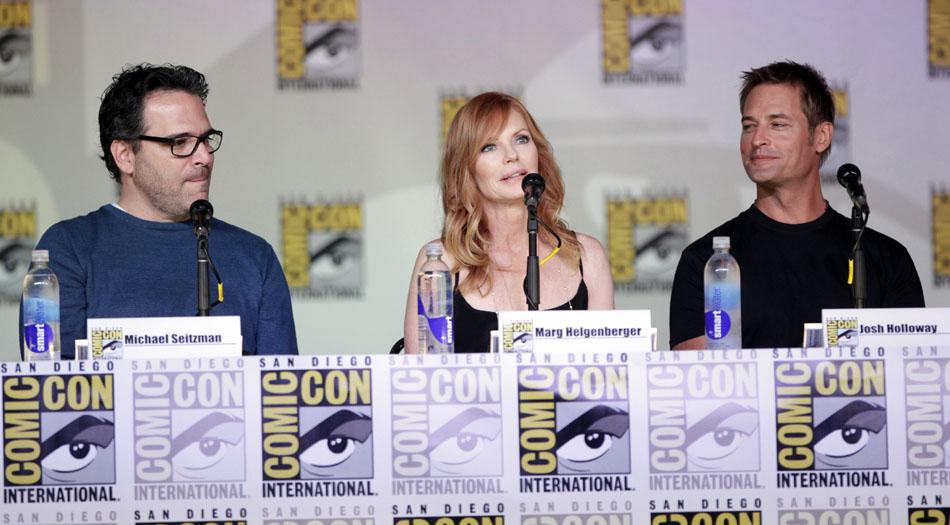 """Producer Michael Seitzman, Marg Helgenberger, and Josh Holloway onstage at the """"Intelligence"""" panel during Comic-Con International 2013 at San Diego Convention Center on July 18, 2013 in San Diego, California."""