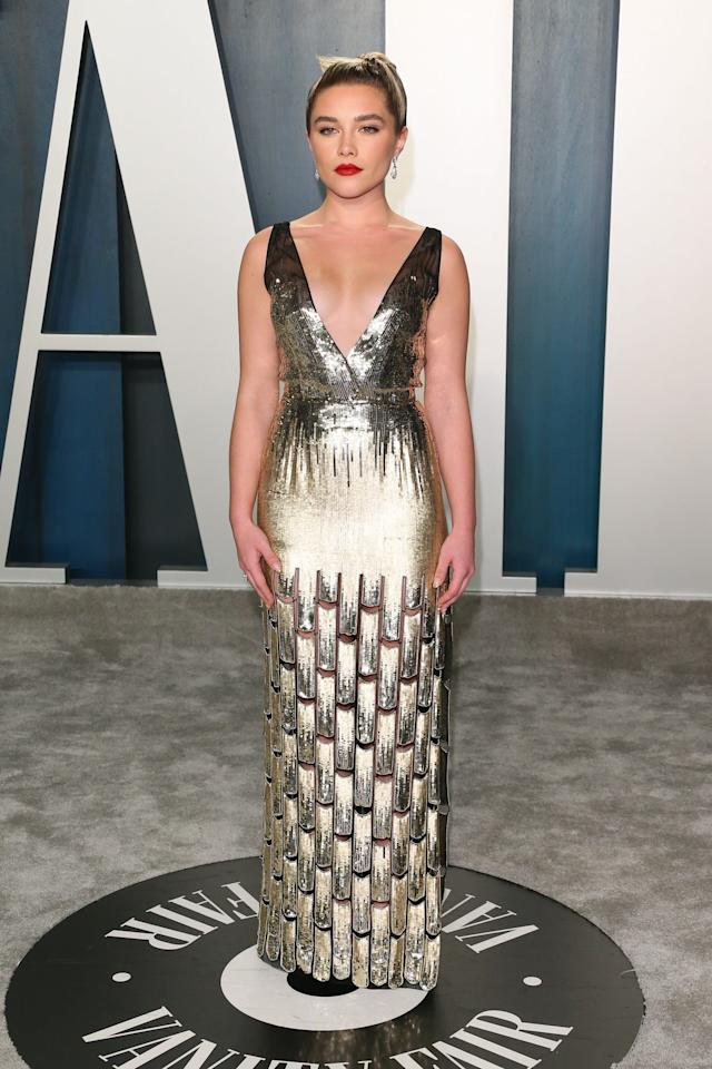 """<p>Wearing a gorgeous sequined <a href=""""https://www.popsugar.com/fashion/florence-pugh-louis-vuitton-dress-at-oscars-afterparty-2020-47202276"""" class=""""ga-track"""" data-ga-category=""""Related"""" data-ga-label=""""https://www.popsugar.com/fashion/florence-pugh-louis-vuitton-dress-at-oscars-afterparty-2020-47202276"""" data-ga-action=""""In-Line Links"""">Louis Vuitton gown</a>.</p>"""