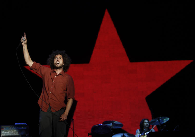 "Lead singer Zack de la Rocha of Rage Against The Machine performs during the ""Rock in Rio"" music festival in Arganda del Rey near Madrid June 11, 2010. REUTERS/Andrea Comas (SPAIN - Tags: ENTERTAINMENT)"