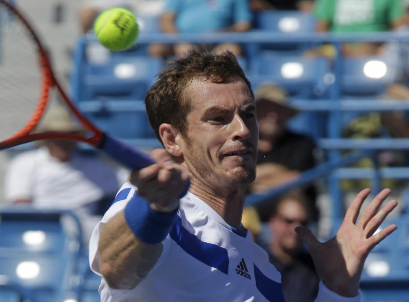 Andy Murray, from Great Britain, volleys against Mikhail Youzhny, from Russia, during a match at the Western & Southern Open tennis tournament, Wednesday, Aug. 14, 2013, in Mason, Ohio. Murray won 6-2, 6-3. (AP Photo/Al Behrman)