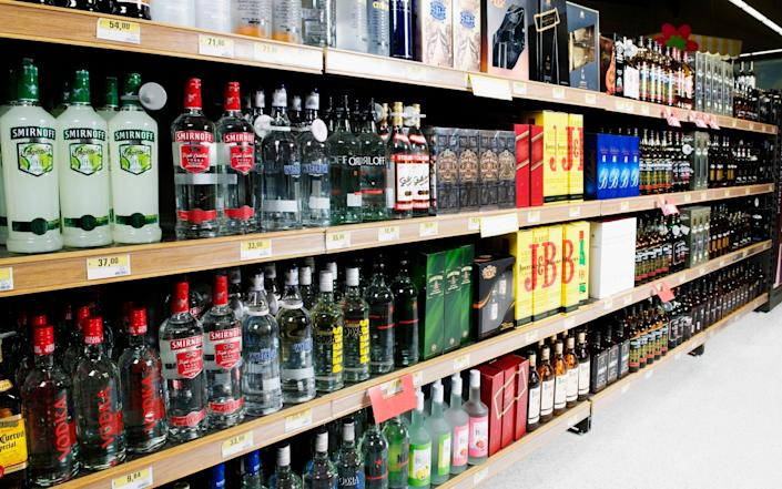 Bottles arranged in a liquor store - Glow Images, Inc/Getty Images Contributor