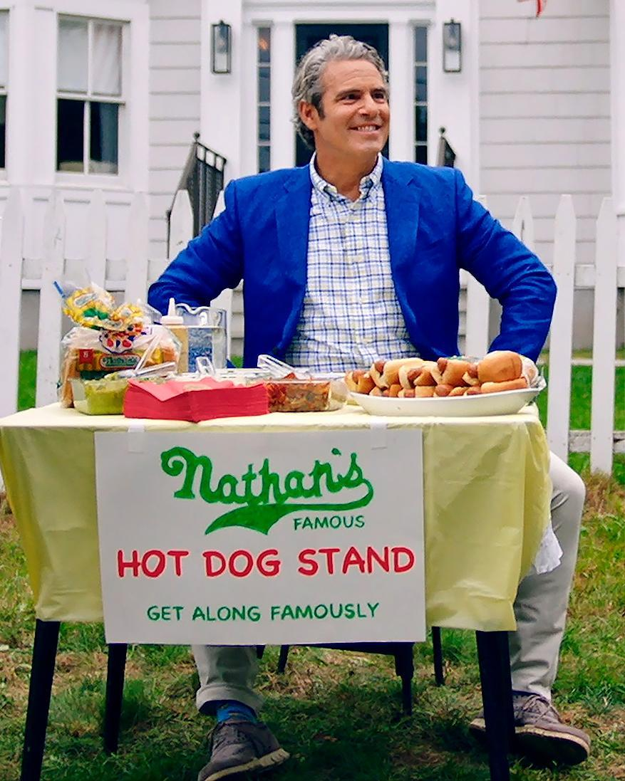 "<p>Andy Cohen enjoys some Nathan's Famous Hot Dogs for their new ""Get Along Famously"" video campaign.</p>"
